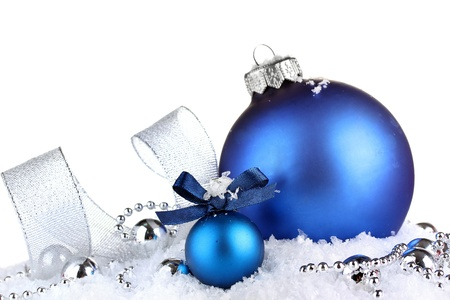 christmas sphere: beautiful blue Christmas balls on snow, isolated on white