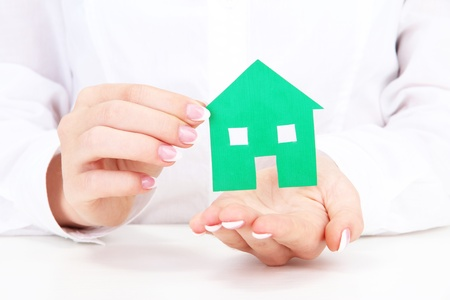 concept: woman hands with paper house, close up Stock Photo - 16339553