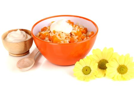 Useful pumpkin porridge in color plate isolated on white photo