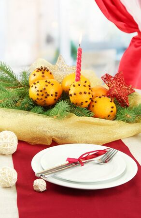 beautiful christmas table setting with tangerines and fir tree, close up Stock Photo - 16341701