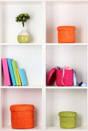 Color wicker boxes on cabinet shelves Stock Photo - 16340210