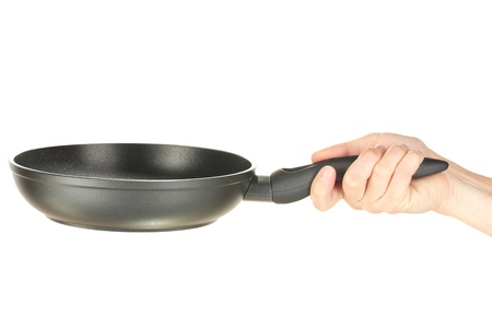 Womans hand holding a frying pan isolated on white Stock Photo