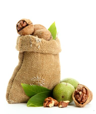 walnuts with green leaves in  burlap bag, isolated on white Stock Photo - 16342497