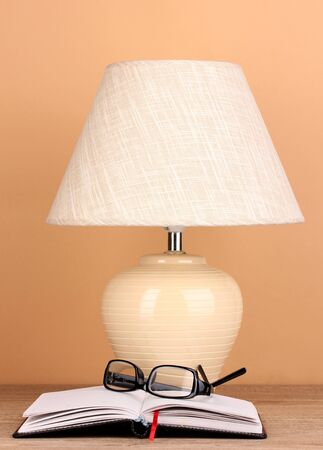 table lamp and glasses on beige background Stock Photo - 16342919