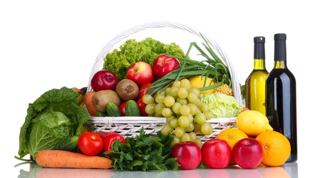 Composition with vegetables and fruits in wicker basket isolated on white Stock Photo - 16342566