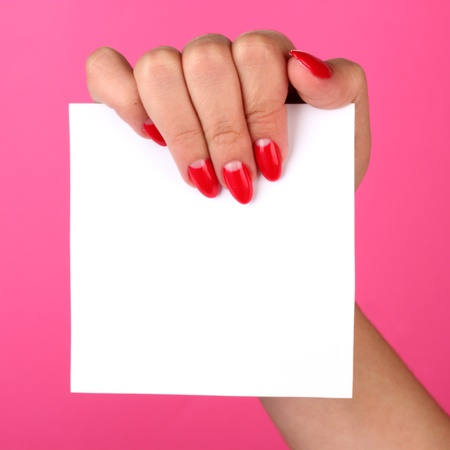 womans hand holding blank card on color background photo
