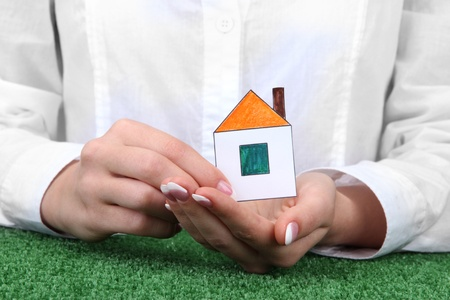 concept: woman hands with paper house, close up Stock Photo - 16342932