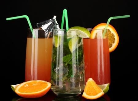 Three cocktails isolated on black photo