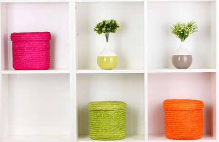 Color wicker boxes on cabinet shelves Stock Photo - 16342773