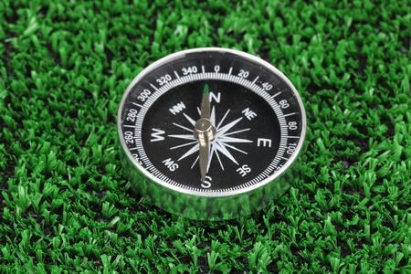 compass on green grass Stock Photo - 16414648