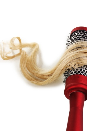 Blond curls brushing comb isolated on white Stock Photo - 16412350