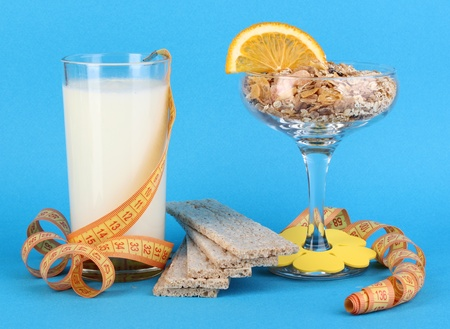 Lungs muesli in vase for desserts and glass milk on blue background Stock Photo - 16413918