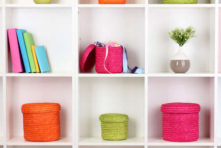 Color wicker boxes on cabinet shelves Stock Photo - 16413681