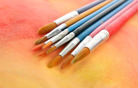 brushes on bright abstract gouache painted background Stock Photo - 16491776