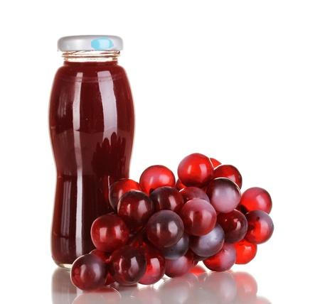 Delicious grapes juice in glass bottle and pink grapes next to it isolated on white Stock Photo - 16490694