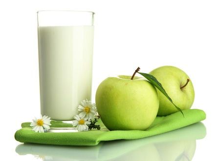 Glass of kefir and green apples, isolated on white photo