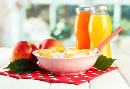 tasty dieting food and bottles of juice, on wooden table Stock Photo - 16491497
