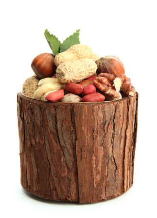assortment of tasty nuts with leaves in wooden vase, isolated on white Stock Photo - 16491642