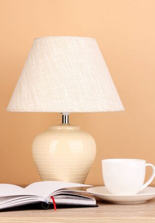 table lamp and cup on beige background Stock Photo - 16479733