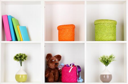 Color wicker boxes on cabinet shelves Stock Photo - 16491675