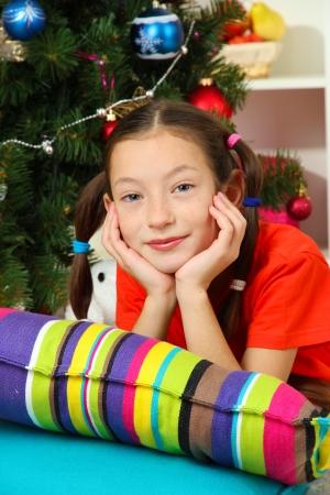 Little girl dreaming near christmas tree Stock Photo - 17129814