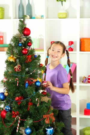 Little girl decorating christmas tree Stock Photo - 17129818