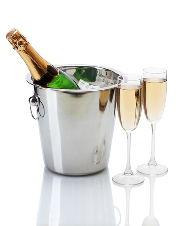green glass bottle: Champagne bottle in bucket with ice and glasses of champagne, isolated on white Stock Photo