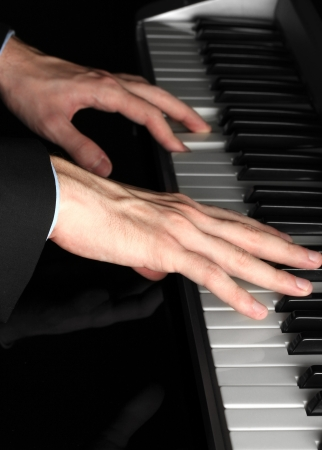 man hands playing piano Stock Photo - 16495544