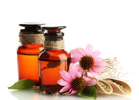 medicine bottles with purple echinacea , isolated on white photo