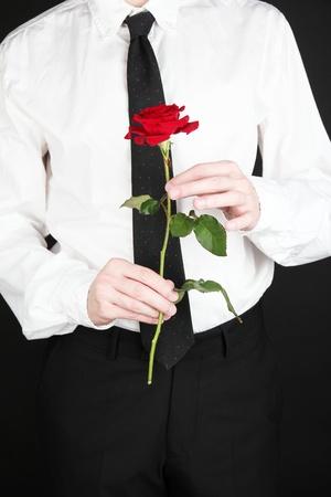 man holding rose close-up photo