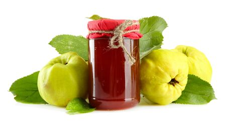 quinces: jar of jam  and quinces with leaves, isolated on white