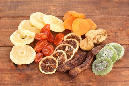 Dried fruits on wooden background photo