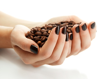 female hands with coffee beans, isolated on white photo