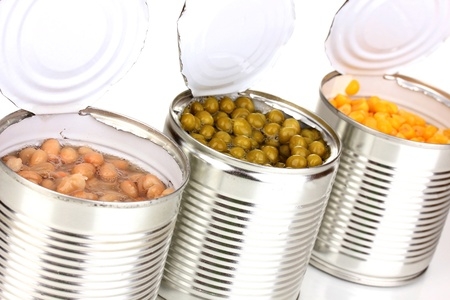 Open tin cans of corn, beans and peas isolated on white Stock Photo - 16495631