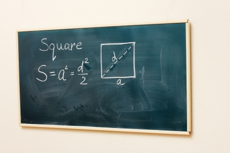 Math formulas written on the desk Stock Photo - 16495798