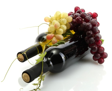 wine  pink: bottles of wine and ripe grapes isolated on white