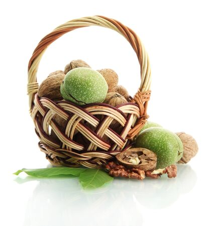 walnuts with green leaves in basket, isolated on white Stock Photo - 16575762