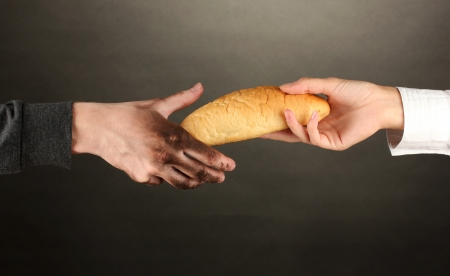 wastrel: helping the homeless, on black background close-up Stock Photo
