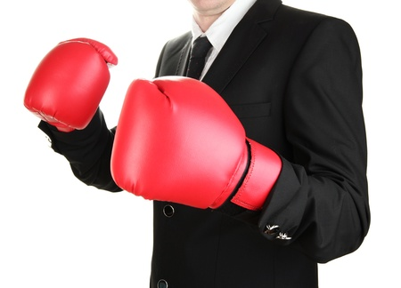 businessman in boxing gloves isolated on white Stock Photo - 16576781
