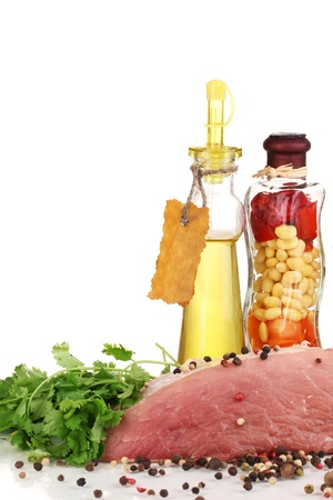 microelements: A large piece of pork marinated with herbs, spices and cooking oil isolated on white