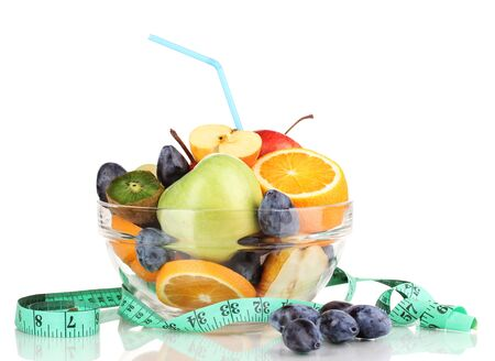 Glass bowl with fruit for diet and measuring tape isolated on white Stock Photo - 16576271