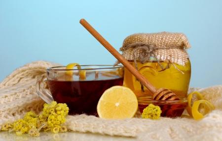 укрепление: Healthy ingredients for strengthening immunity on warm scarf on blue background Фото со стока