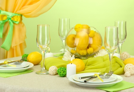 beautiful holiday table setting with lemons, close up photo