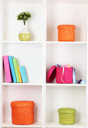 Color wicker boxes on cabinet shelves Stock Photo - 16592257