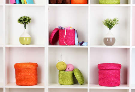 Color wicker boxes on cabinet shelves Stock Photo - 16592547
