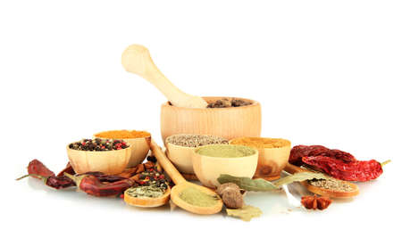 wooden mortar, bowls and spoons with spices isolated on white photo