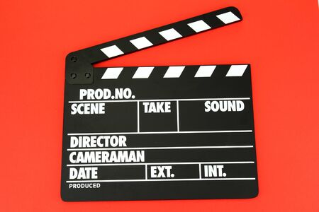 Movie production clapper board on color background photo