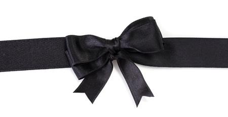 black bow on ribbon isolated on white photo