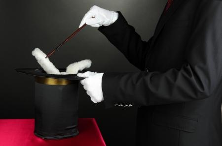 magician performance on dark background photo