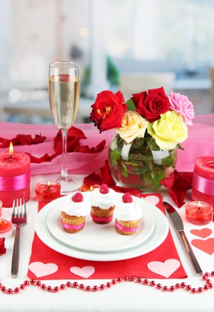 amorousness: Table setting in honor of Valentines Day on room background Stock Photo